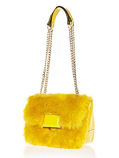 Faux fur chain handbag, £28, River Island. www.riverisland.com