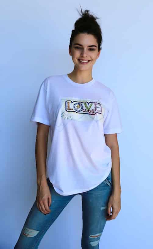 Kendall Jenner wears LOVE Club x Itchy Scratchy Patchy T-shirts Photo: Hugo Scott Styling: Katie Grand