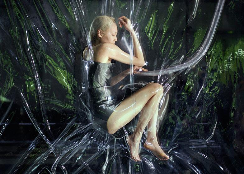 Models were suspended in vacuums between plastic sheeting during van Herpen AW14. Picture: Dezeen.