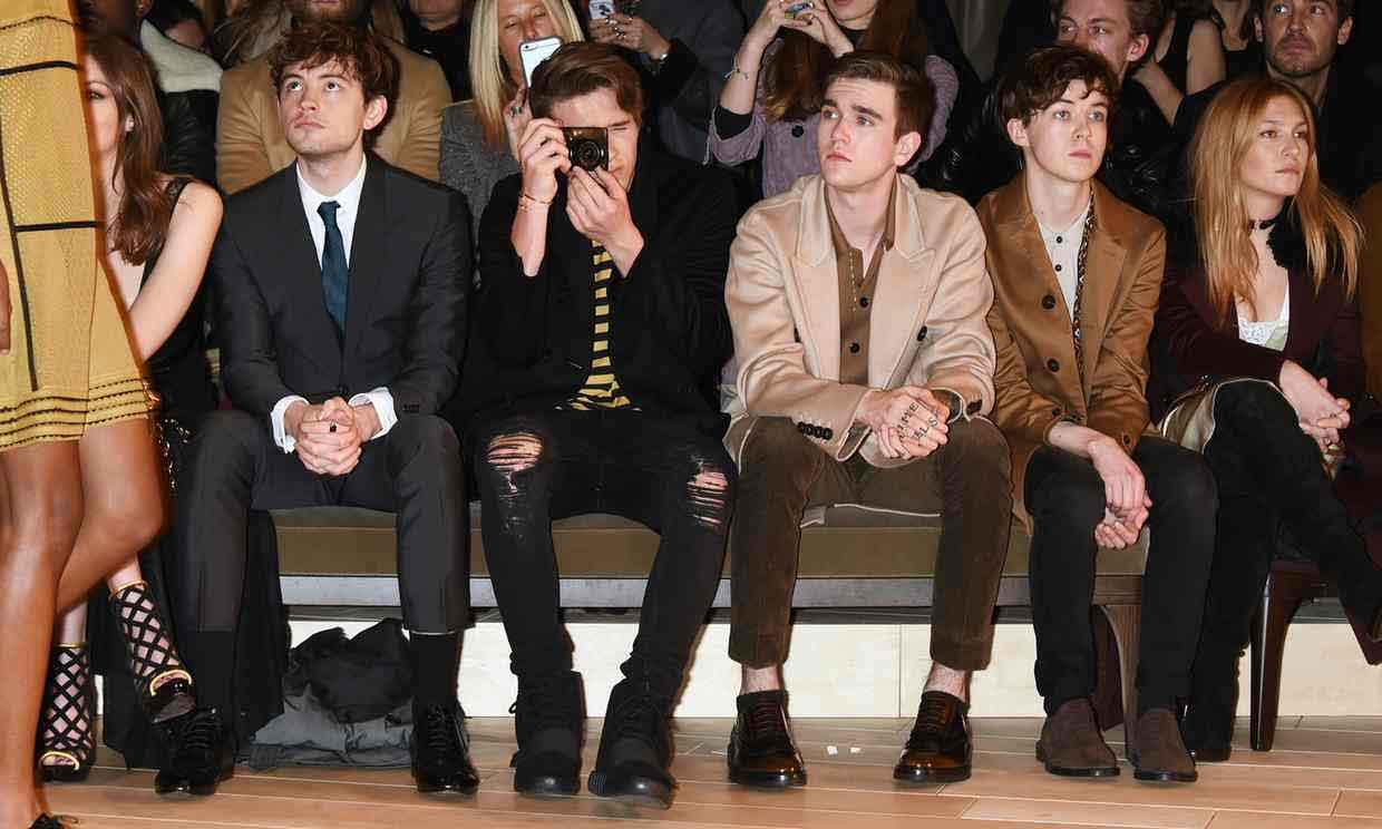 Brooklyn Beckham, with camera, in the front row for the Burberry January 2016 show in London. Photograph: David M Benett/Getty Images for Burberry