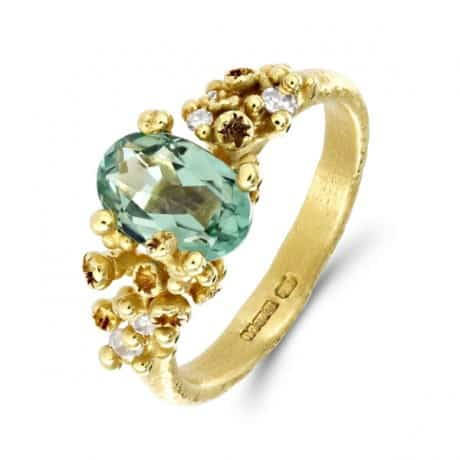 RUTH TOMLINSON. Cluster Oval Green Tourmaline Diamond Gold Ring, £1,580. www.econe.co.uk
