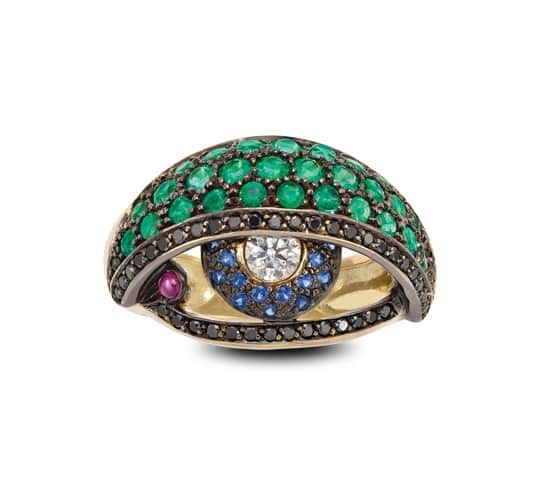 SOLANGE. Diamonds, Emeralds, Sapphires and Rubies in blackened 18ct yellow gold Eye ring, £POA.
