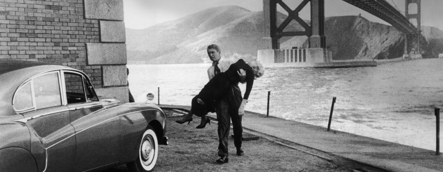 Still from Hitchcock's Vertigo: Scottie rescues ....