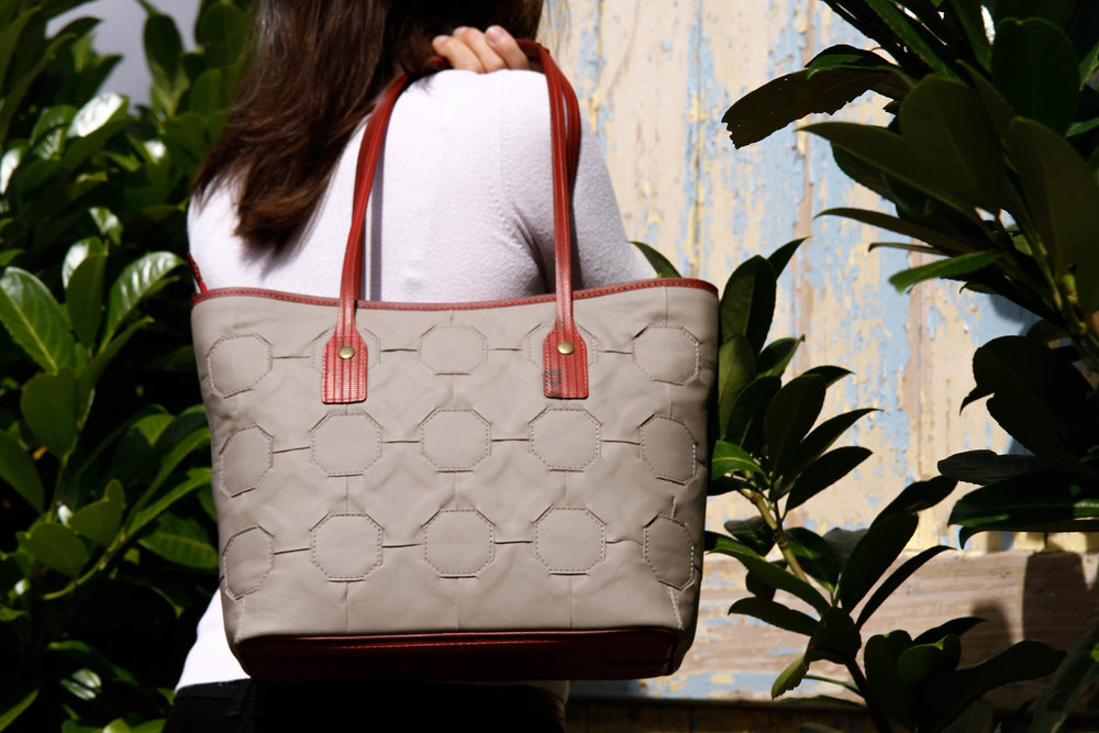 Waste leather is handcut and handwoven into a single 'skin' and made into beautiful totes and bags. Picture: Elvis & Kresse.