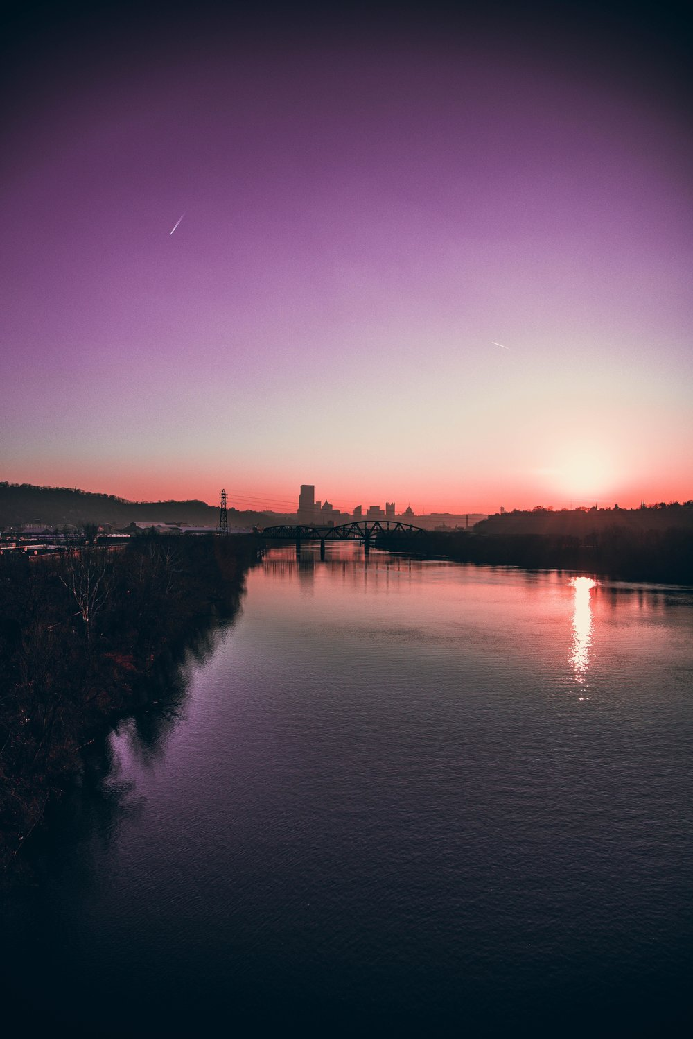 Sunset over downtown Pittsburgh, photo taken from 40th St. Bridge overlooking the Allegheny River.