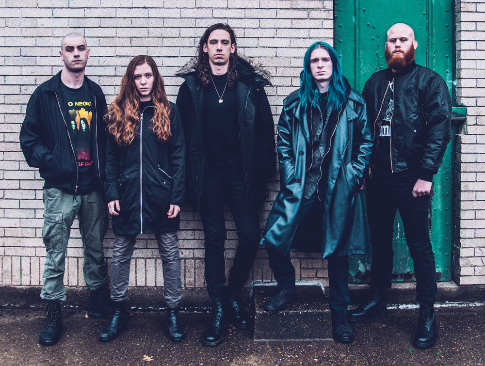 From left: Code Orange members Dominic Landolina, Reba Meyers, Jami Morgan, Eric Balderose, and Joe Goldman gather for a photo in Pittsburgh's Squirrel Hill neighborhood.