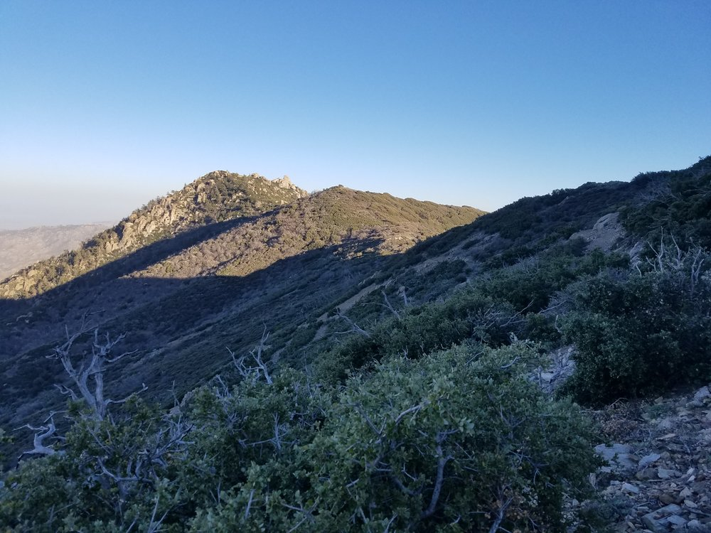 Hiking along the windy ridge, trying to find a sheltered campsite.