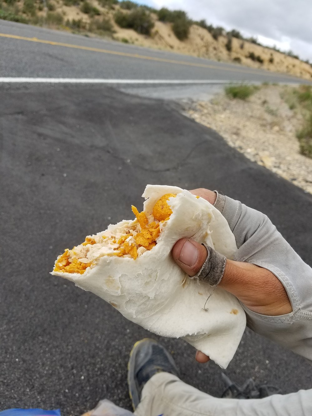 Mowing down ghetto fish tacos on the side of the road like a degenerate.