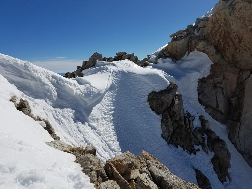 """Stumpy cornice at the pass. I'd been warned of a """"massive"""" and """"impassible"""" cornice here... not quite. I'm not complaining though."""
