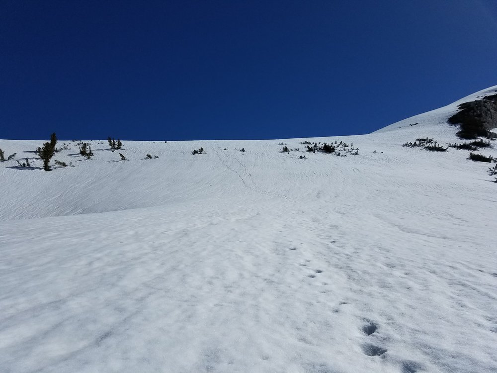 Faint footsteps from those ahead of us, leading up to the pass.