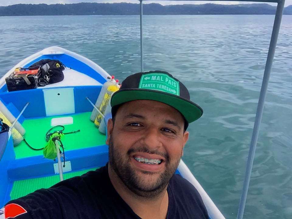 "Captain Alonso - ¡El capitán! Raised in the tiny coastal village of Cabuya, Alonso grew up in the ocean that is now his ""office"". He knows it like no one else and is the most skilled boat driver we know, easily maneuvering our boat through large waves, strong currents and rocky channels. In addition, he is the Malpaís port's go-to mechanic for outboard motors plus he is a certified diver so we feel especially safe with him! PADI #15040Y8609"