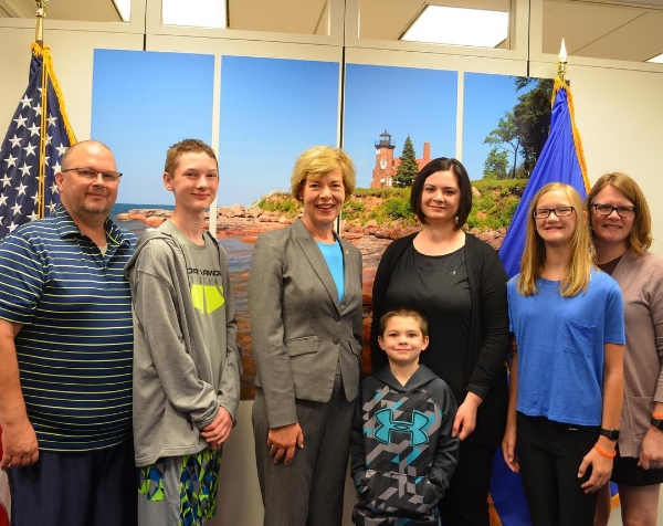 Aiden and his family and Allison and her family with Senator Tammy Baldwin.