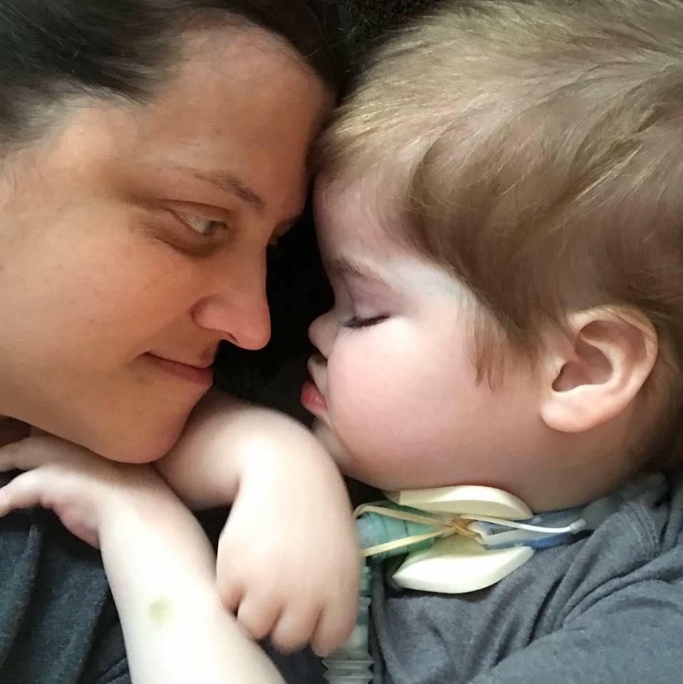 Image description: Tonya (the author) and her son Colton embracing nose to nose.