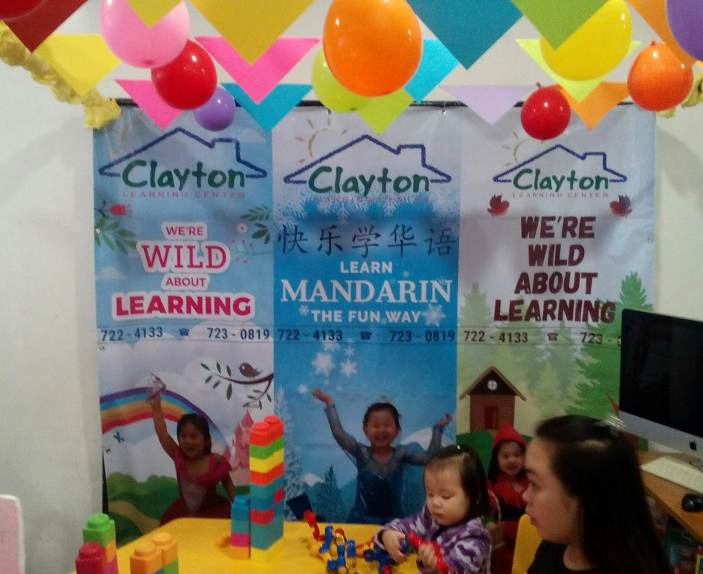 Happy child at the Clayton Learning Center booth