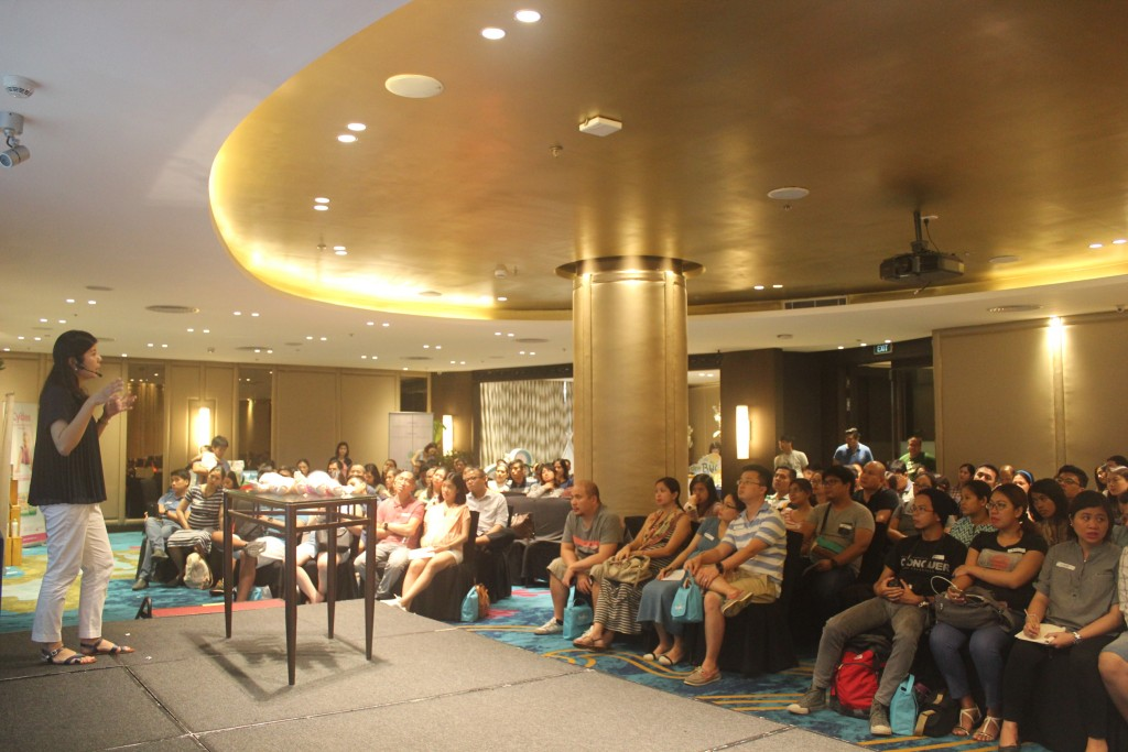 The Dusit Thani function room was packed with new parents eager to learn
