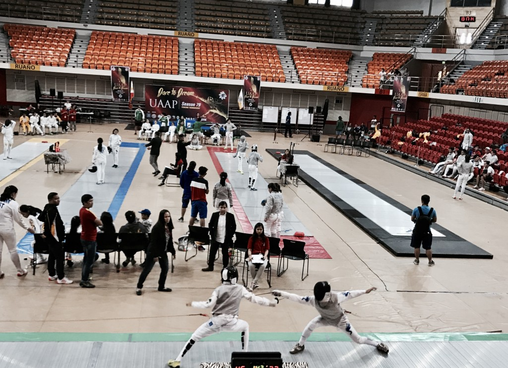 Coby at a fencing competition