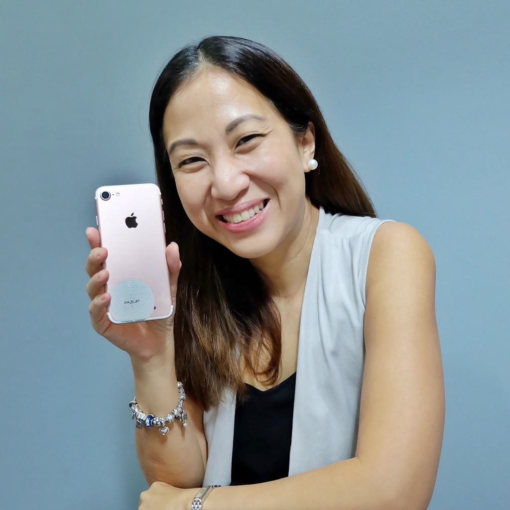 Mommy Mundo Founder Janice Villanueva shows the Fazup patch on her phone.
