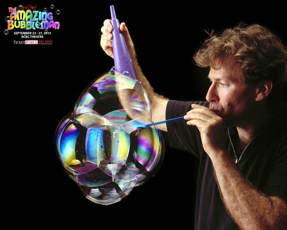 Louis_blowing_w_purplecone.jpg