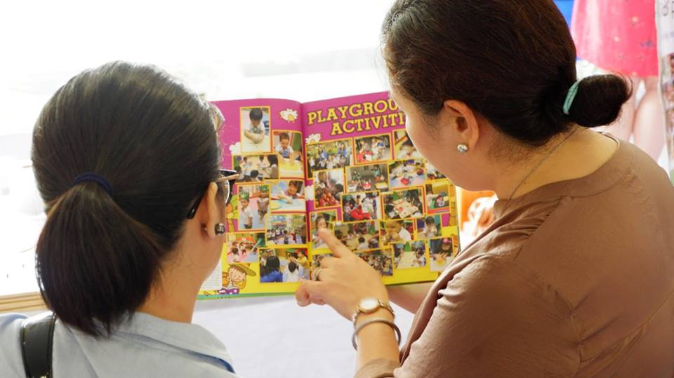A teacher explaining the school's various activities