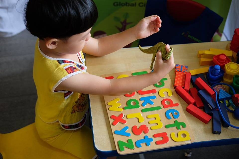 A child playing while learning the alphabet