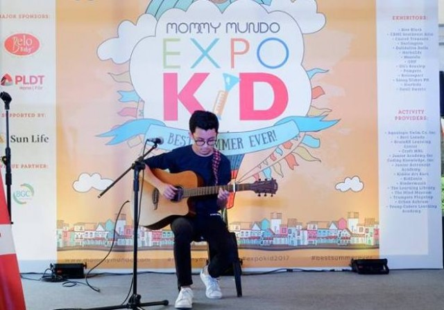 Talented guitarist Lucas Pison entertains the families at Expo Kid.