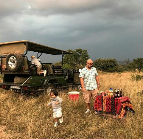 Chal's husband and their boys at an African safari