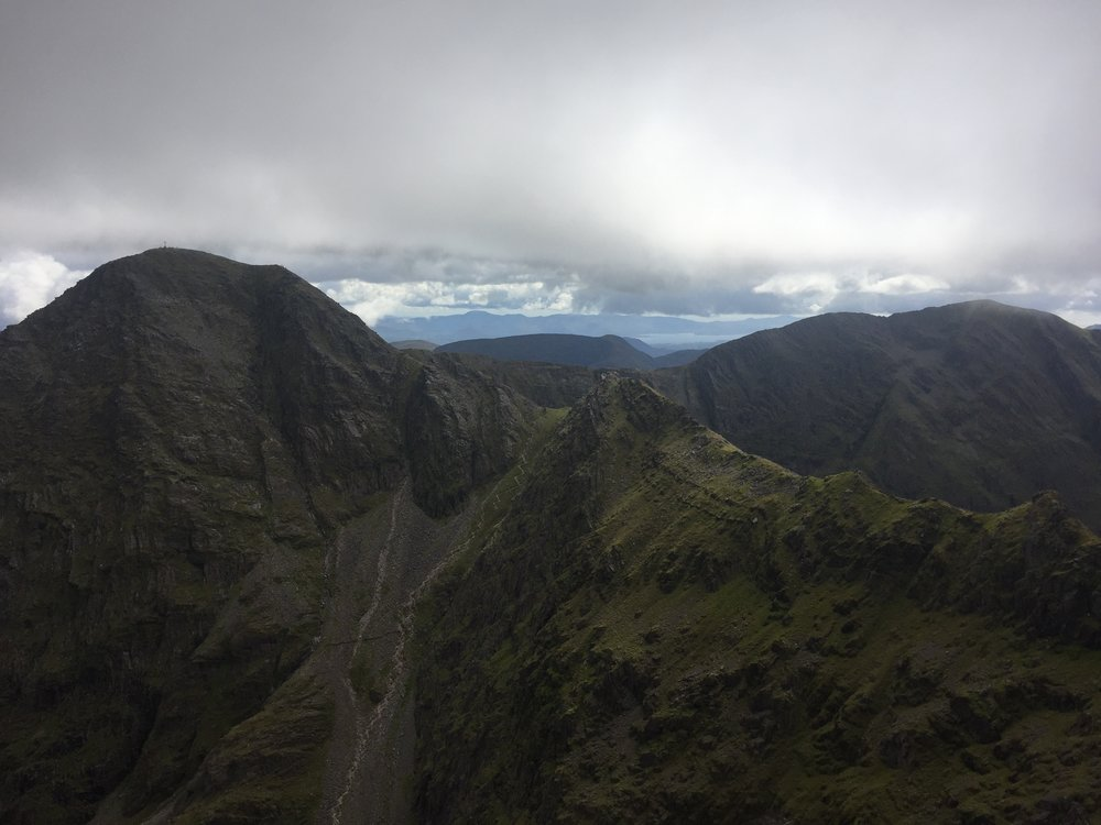 The ridge leading from Carrauntoohil and its giant iron cross