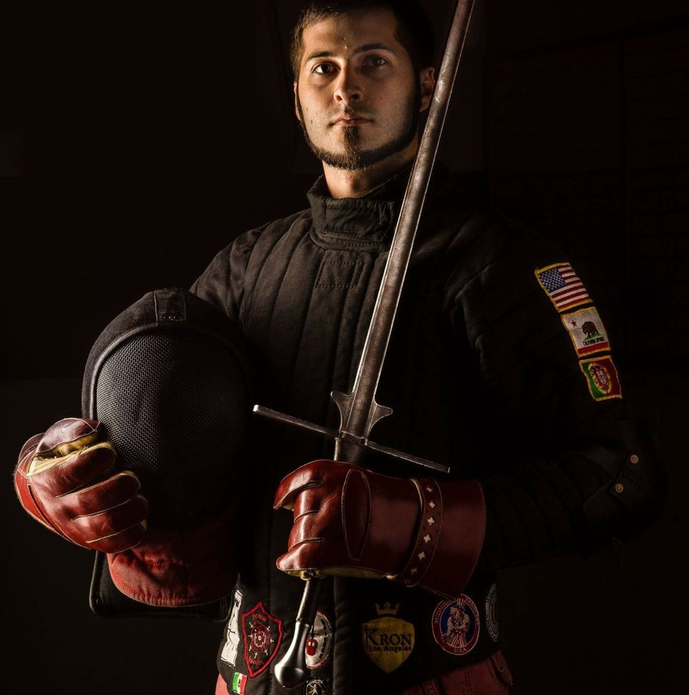 RJ McKeehan   Specializations  Longsword Cutting Messer  A multiple Gold Medalist in cutting, RJ has been practicing HEMA for nearly a decade. He has worked with the best instructors in the world, and continues to regularly attend events and compete worldwide. He has appeared as a weapons expert on television shows including Mythbusters and Man at Arms: Art of War. RJ co-founded SCS with Jonathan Mayshar, and runs the webstore.