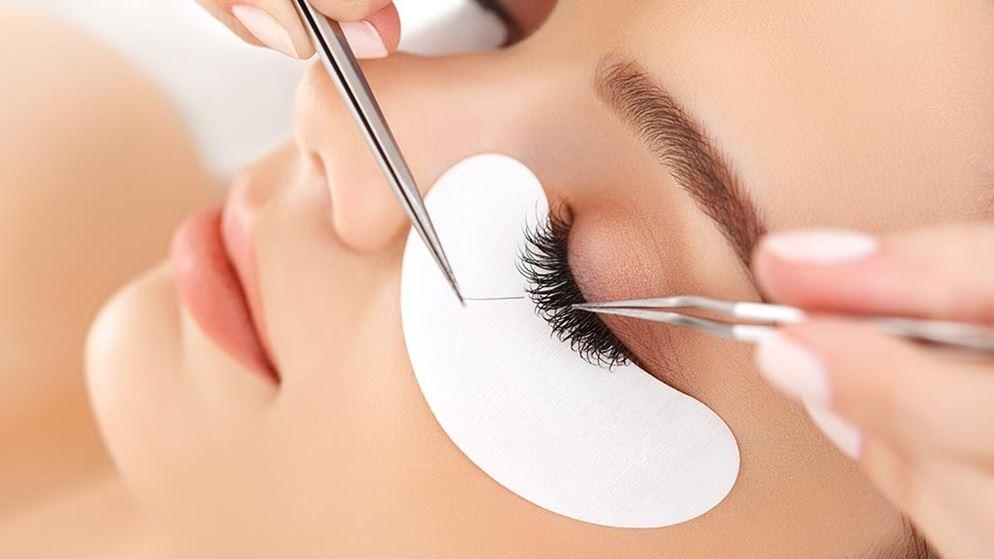 woman getting eyelash extensions.jpg