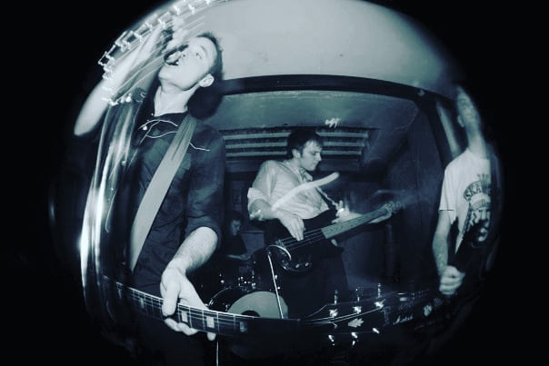 This is one of the first photos I can find of Dissociates online, funnily enough it was taken almost exactly ten years ago to the day today (31.03.09). It was taken by our boy @tommattey1 at headline show we played in the basement of the @conincamden pub by the canal down in Camden town. There are a fair few songs that we'll be playing ten years later from that old school set list tonight at the farewell show, see you at @diyspaceforlondon tonight for the final ride out! . . . . . . . . #punkband #punk #punkrock #punkrockbands #camden #camdentown #theconstitutioncamden #theconstitution #gibsonsg #fisheye #photography