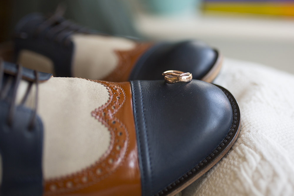 grooms wedding shoes and wedding bands Sophie Lake Photography