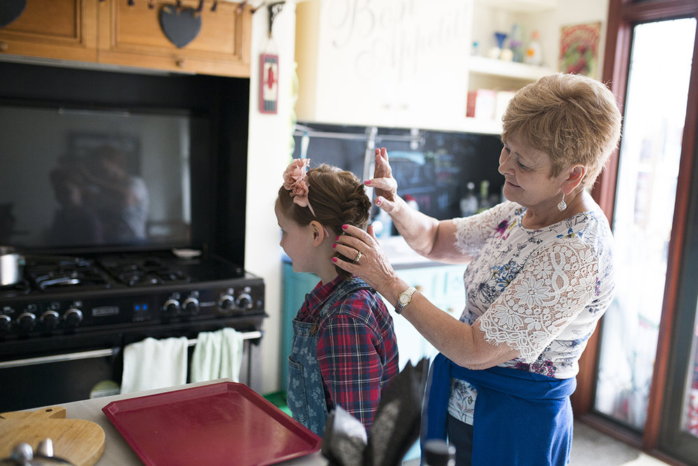grandmother doing granddaughters wedding hair