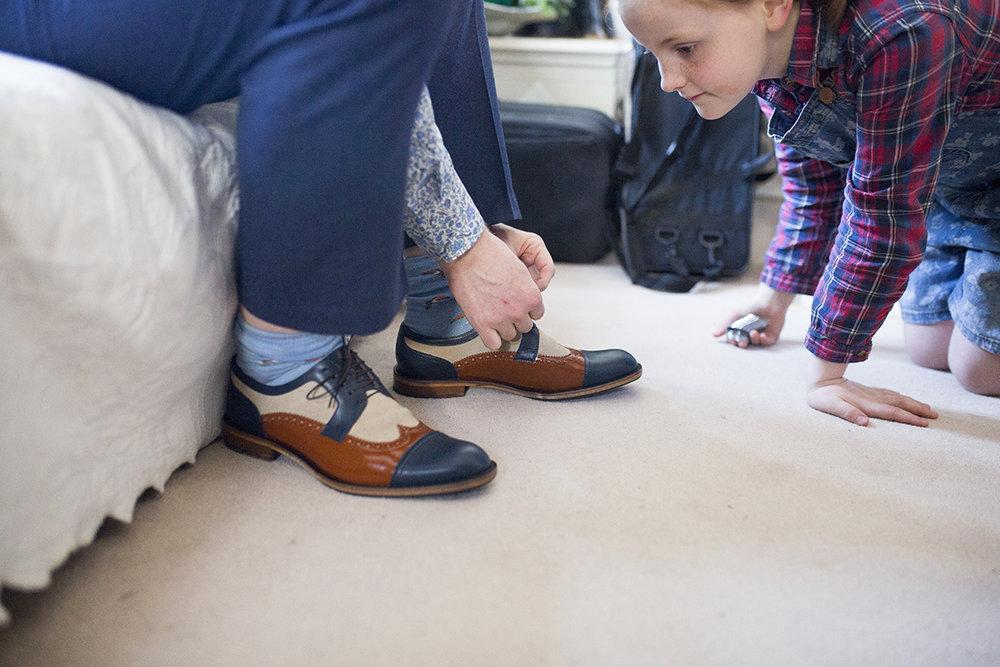 groom tying his shoelaces