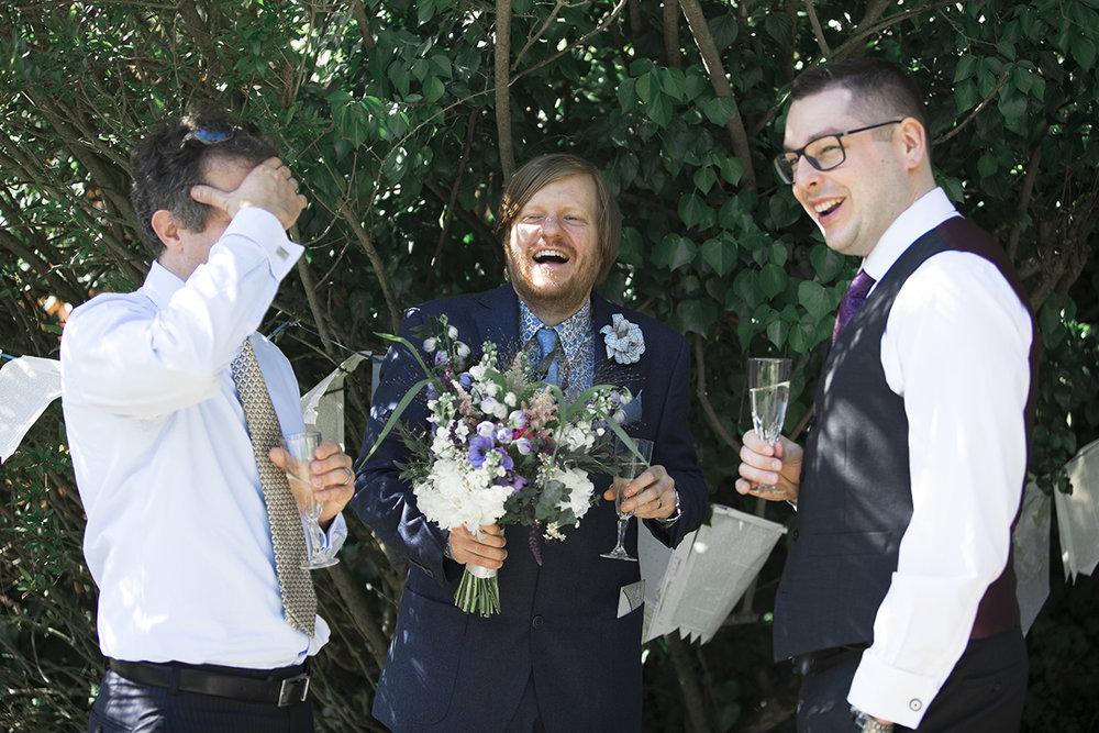 Groomsmen laughing Sophie Lake Photography