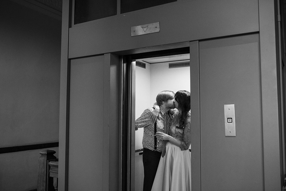 Bride and Groom kissing in lift Sophie Lake Photography