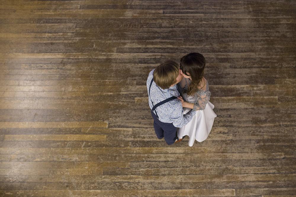 bride and groom kissing on dance floor
