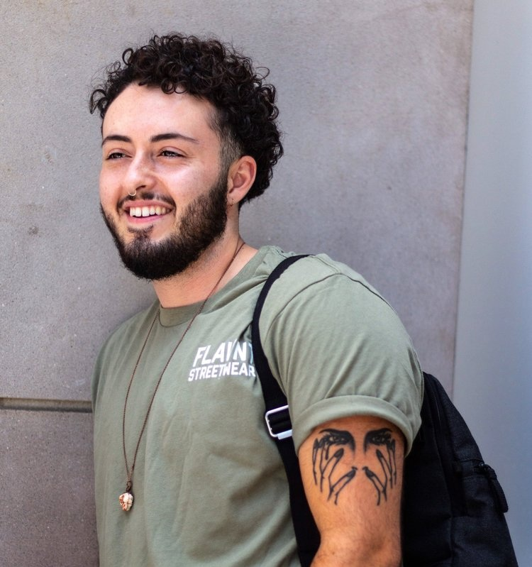 """Issa Ismail - Issa is the main subject of """"A Year In Transtion"""" and was a co-founder of FTM A2-Ypsi, which is a support group for transmasculine people in the Metro Detroit area. Issa is always working on new projects to help educate and normalize trans lives, so please reach out if you'd like to collaborate."""
