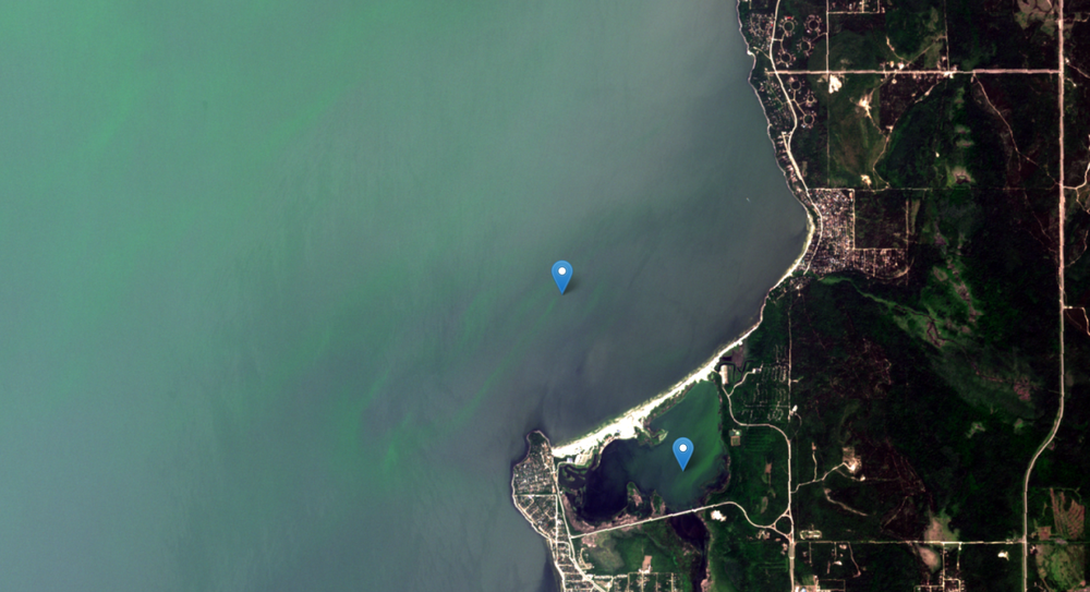 August 9, 2018. Blooms have drifted nearshore to the east side beaches, shown with location markers. The Grand Beach lagoon has abundant algae now.