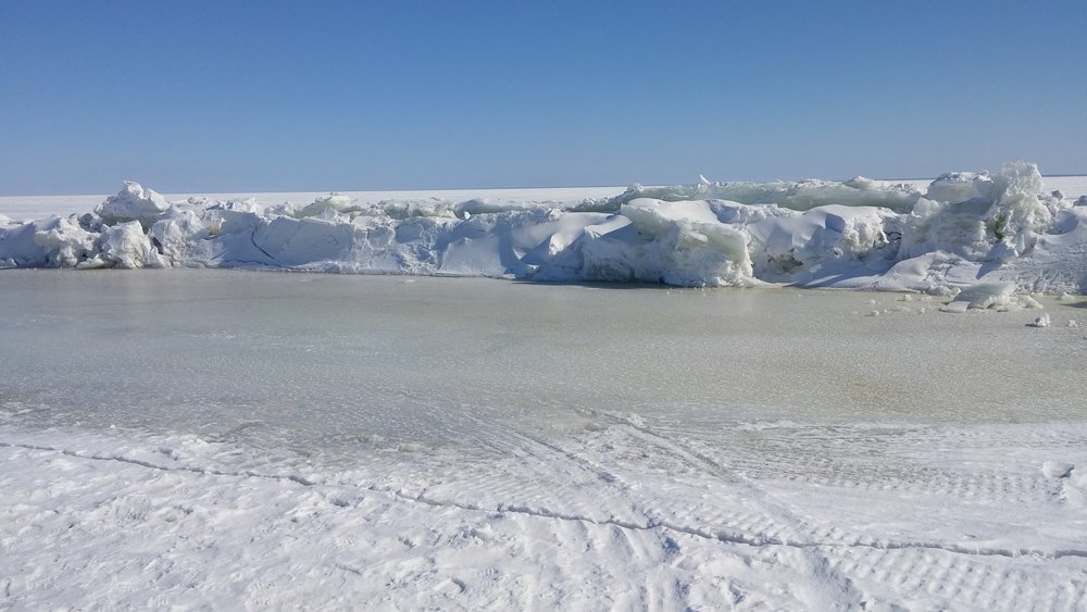 Pressure ridges are ice deformations that include troughs on either side. The ridge and troughs are relatively weak ice and decay early to form a lead.
