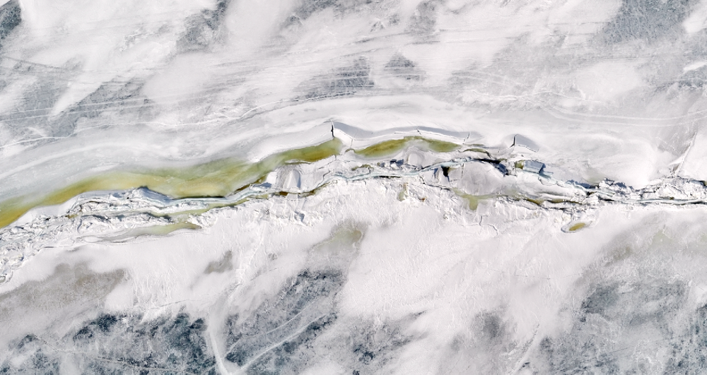 April 11, 2018 - Ice sheet moves 1.6 m and closes crack along ridge. Fixed wing drone data collected during Diurnal Melt Period.