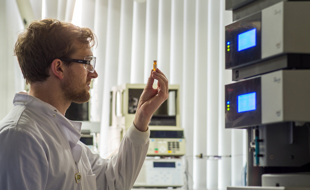 Me looking into a tiny beaker like a genuine science person