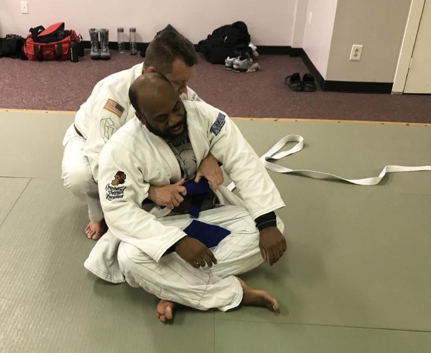 Coach Daniel secures the blue belt