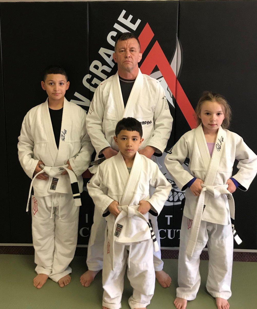 Hiram, Logan, & Olivia with Coach Daniel