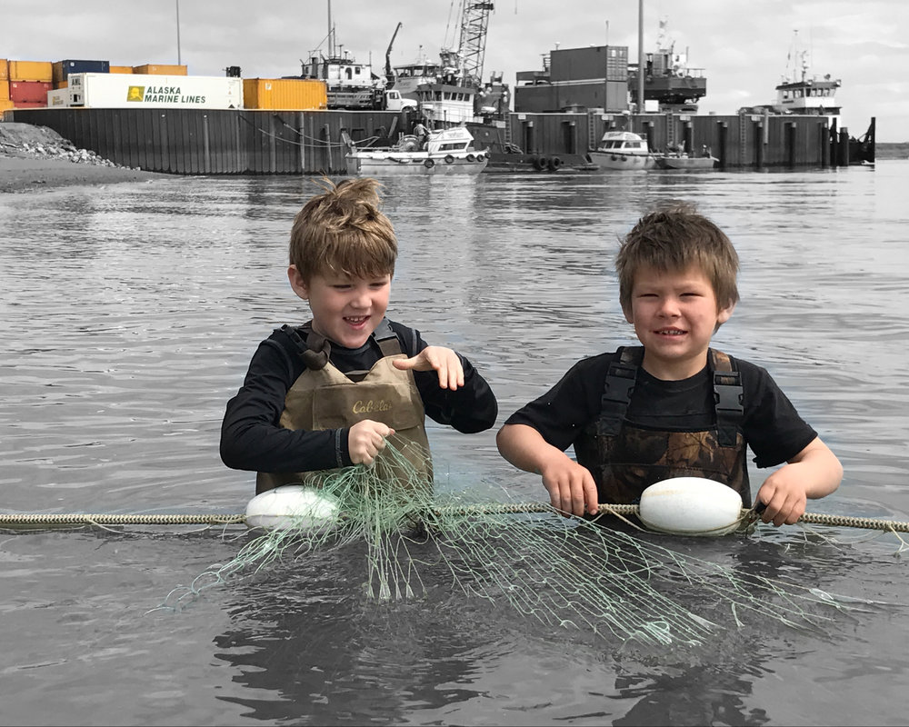 Victor Thompson and Name Savo picking their families subsistence fishing net near the Port of Bristol Bay on the Naknek River.