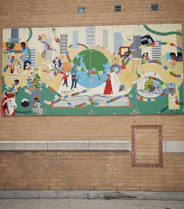 A 2008 community mural mounted outside Rose Park Avenue Public School displays the neighbourhood's diversity. The elementary school is attended by many children from the 650 Parliament Street towers .   Photo: Jahan A., Jamhoor