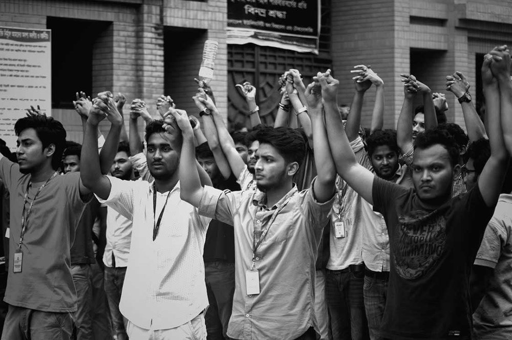 Students of Bangladesh University of Business & Technology (BUBT) form a human chain in front of their campus at Mirpur 1.