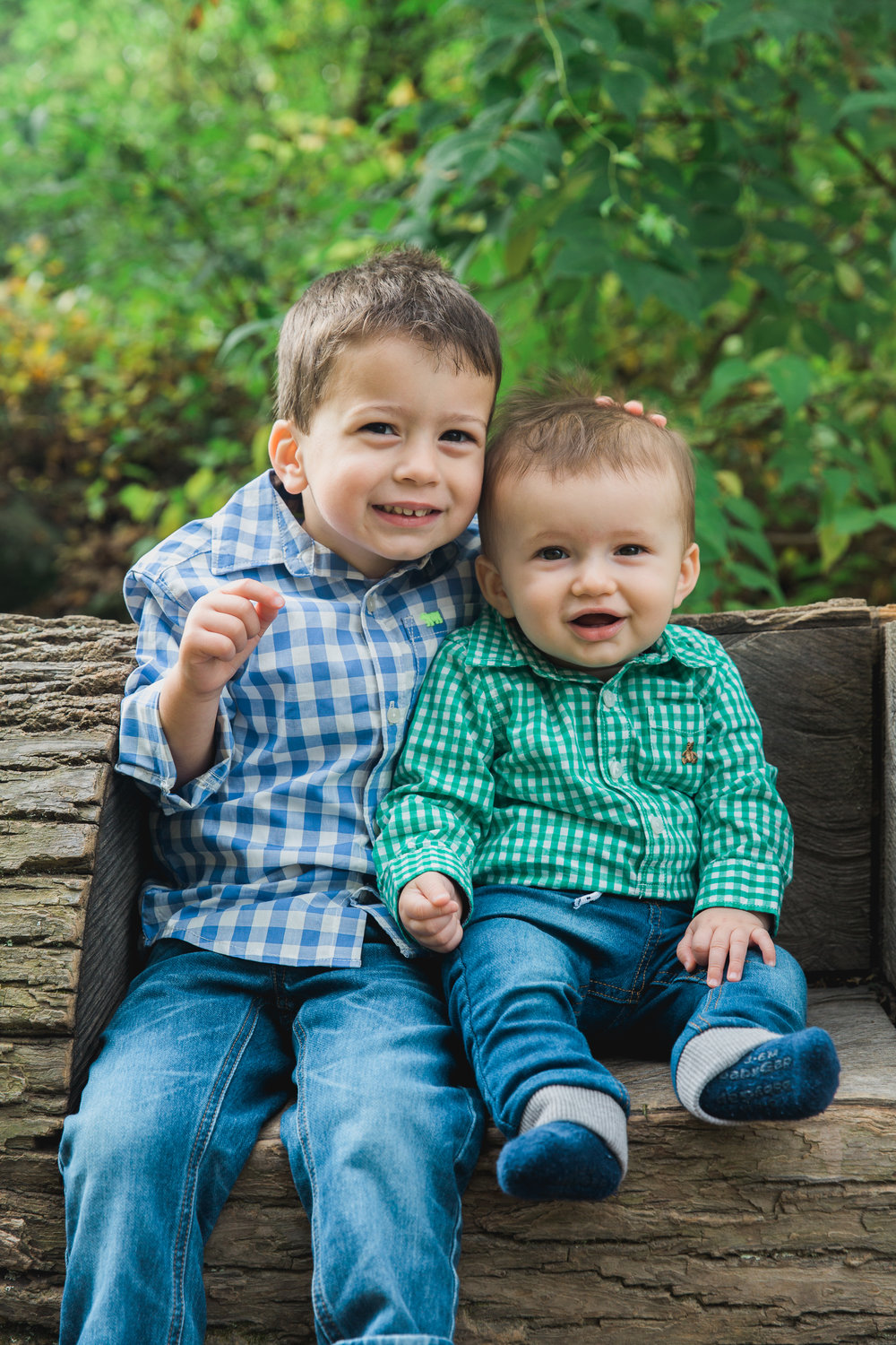 Joy Uyeno Greater Boston family photographer with toddler boys at Drumlin Farms in Lincoln Massachusetts