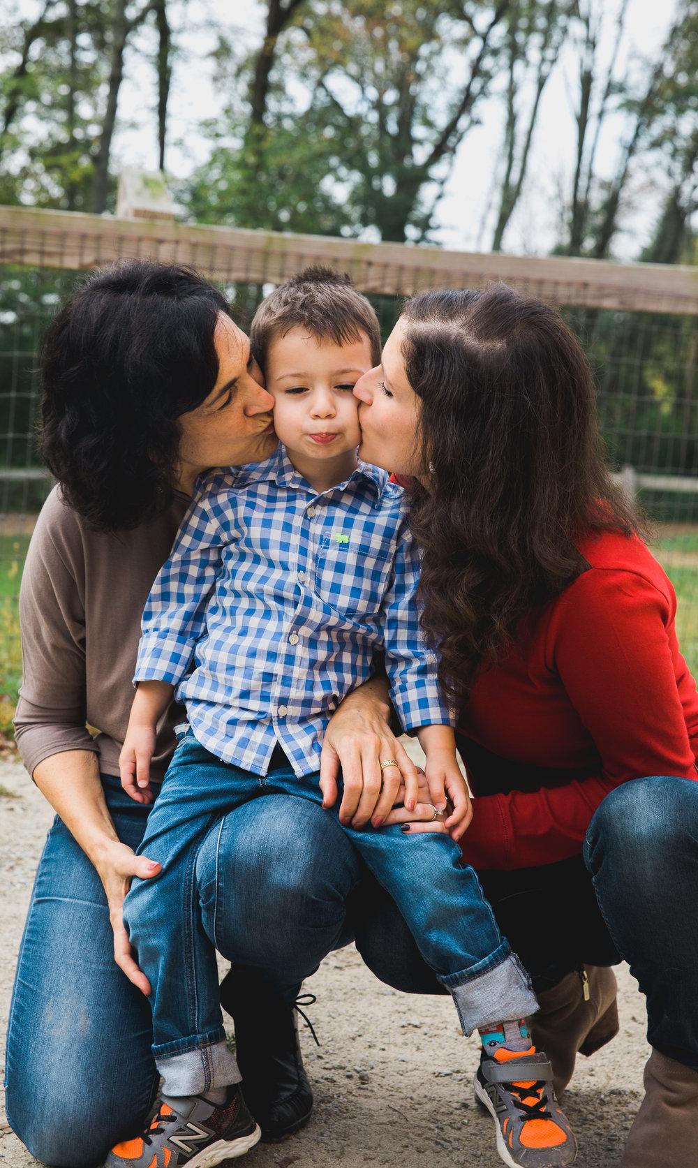Joy Uyeno Greater Boston family photographer grandma and mom kiss toddler boy in Lincoln, Massachusetts