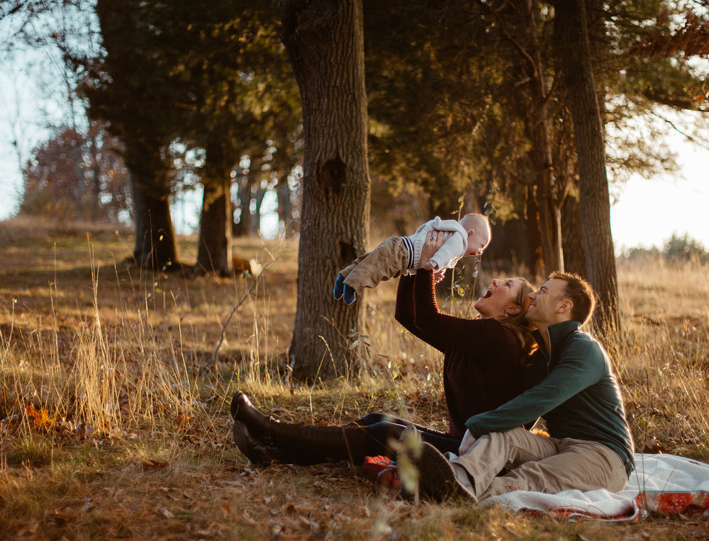 Joy Uyeno Greater Boston family photographer happy family under the trees during fall