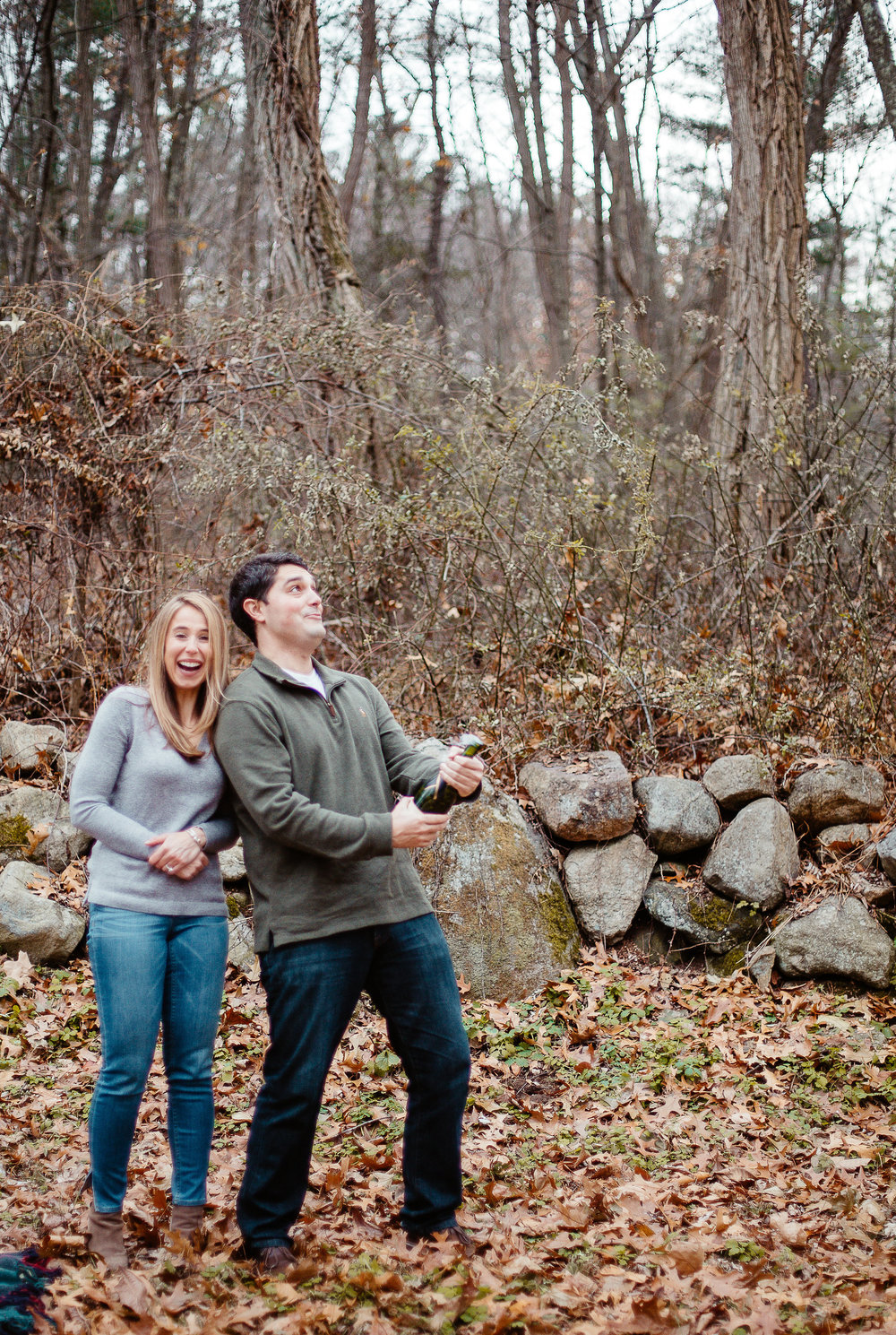 Joy Uyeno Greater Boston engagement photographer champagne toast in the woods of Concord, Massachusetts